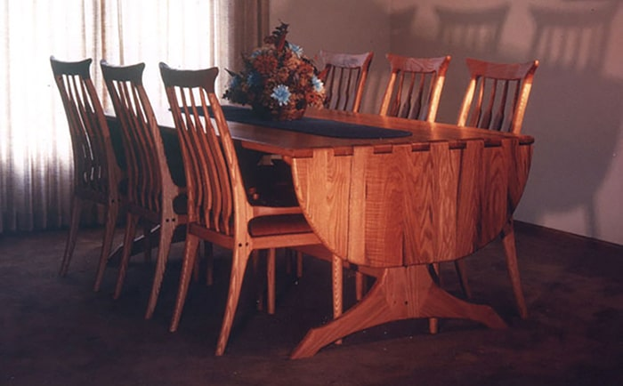 Oak drop leaf dining table and chairs